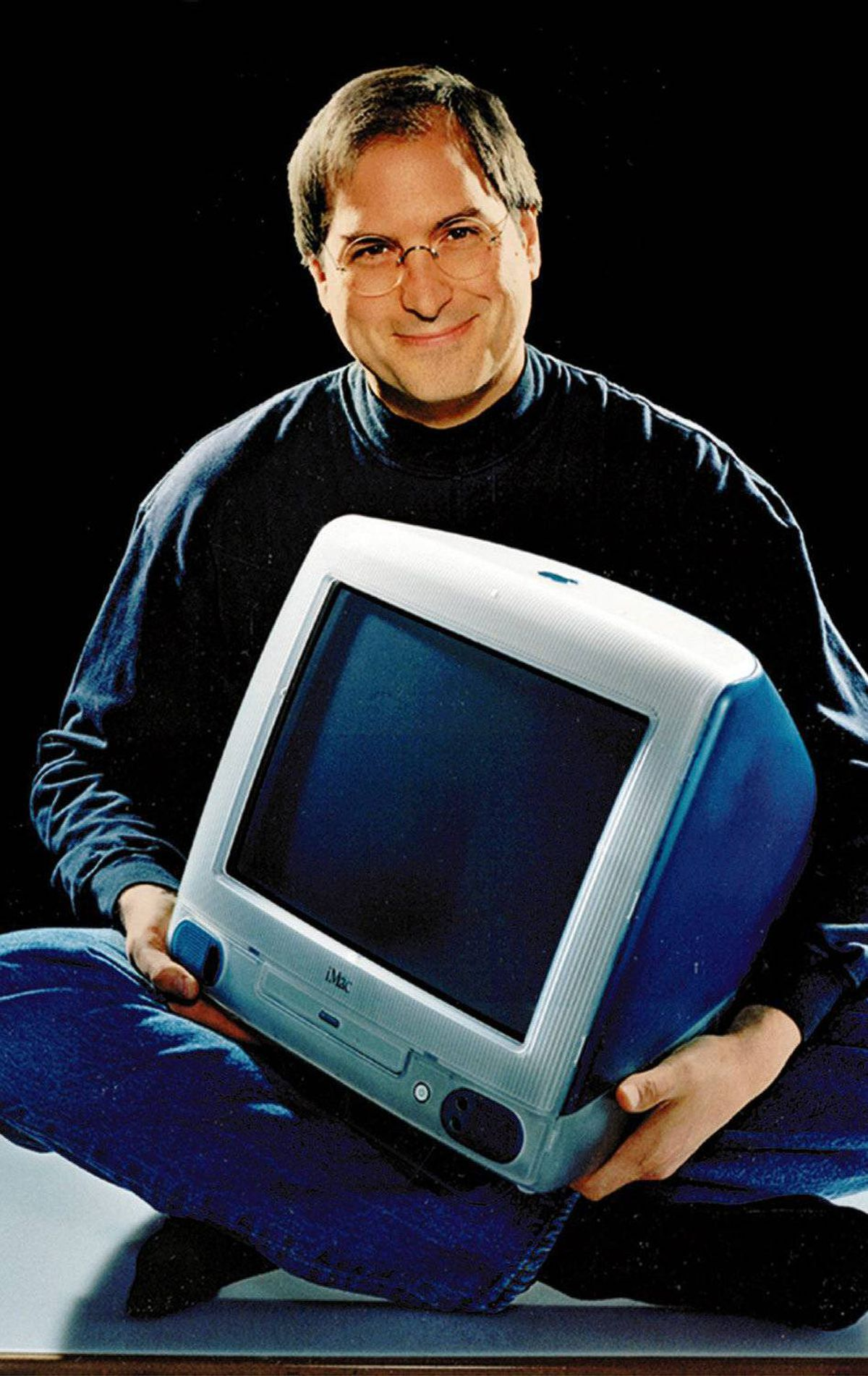 FILE - This 1998 file photo provided by Apple shows Apple CEO Steve Jobs holding an iMac computer. Apple Inc. on Wednesday, Aug. 24, 2011 said Jobs is resigning as CEO, effective immediately. He will be replaced by Tim Cook, who was the company's chief operating officer. It said Jobs has been elected as Apple's chairman. (AP Photo/Moshe Brakha, File)