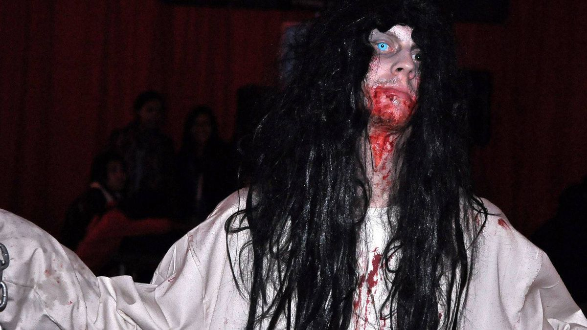 """An actor gets into character as a crazed doctor before the doors open. """"We give pep talks to everyone before the night begins,"""" says general manager Andrew Gidaro. Prizes are given out nightly to best individual actor and the actors in the attraction that generated the most scares the previous night, Mr. Gidaro says."""