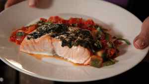 Roasted salmon in tomato zucchini sauce.
