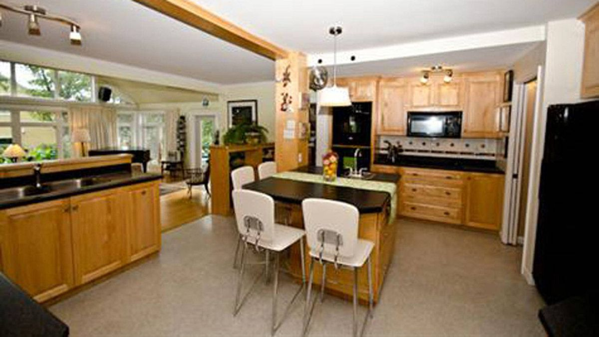 The updated kitchen has an open layout, with centre island, new appliances and pantry.