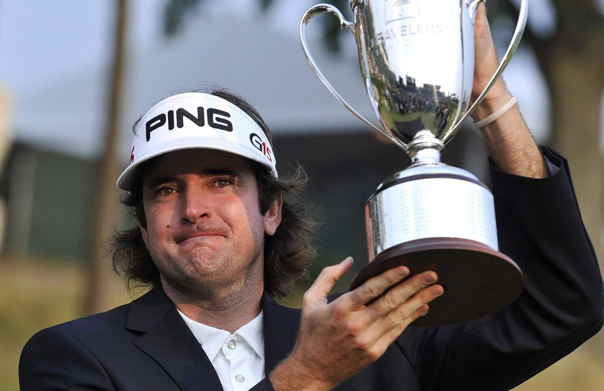 Bubba Watson holds up the championship trophy at the Travelers Championship golf tournament on Sunday, June 27, 2010, in Cromwell, Conn. Watson won for the first time on the PGA Tour, coming from six shots down to win the Travelers Championship in a three-way playoff. (AP Photo/Jessica Hill)