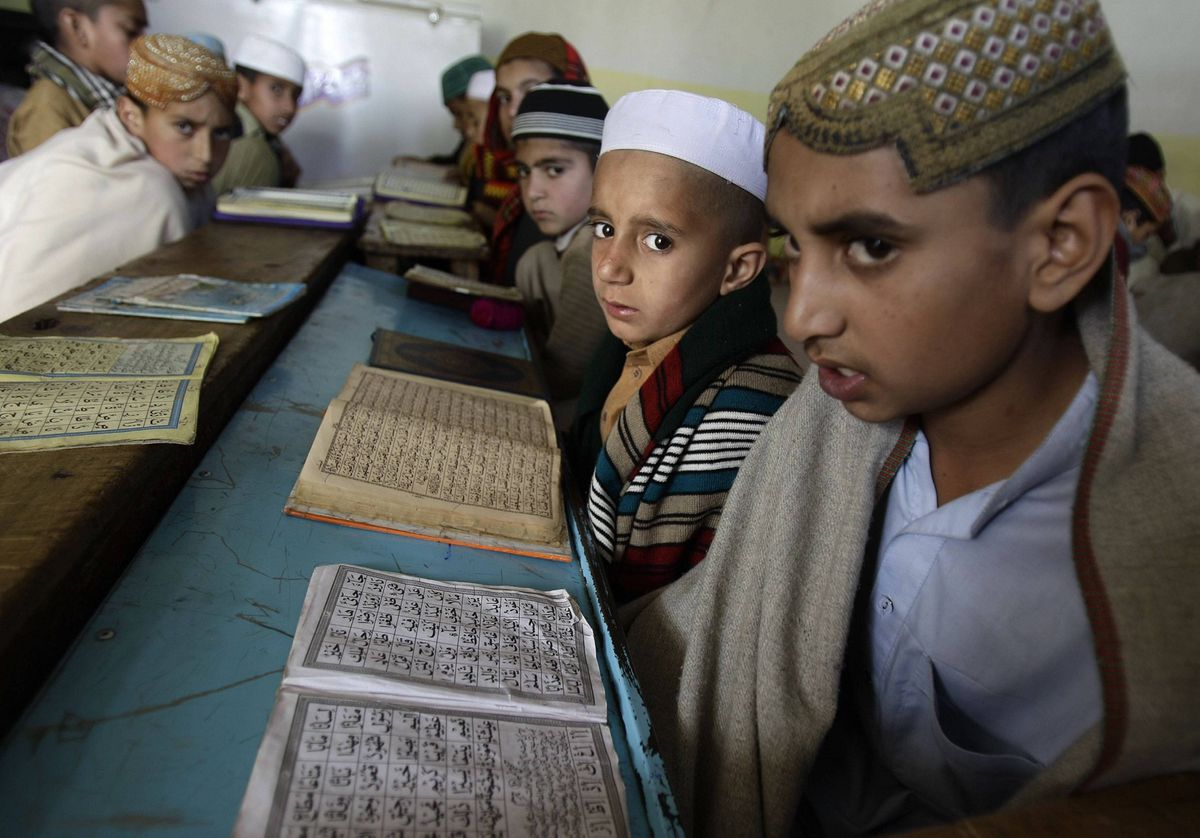 Pakistani boys attend a madrassa, or Islamic school, set up in a mosque near the demolished compound of Osama bin Laden, in Abbottabad, Pakistan.