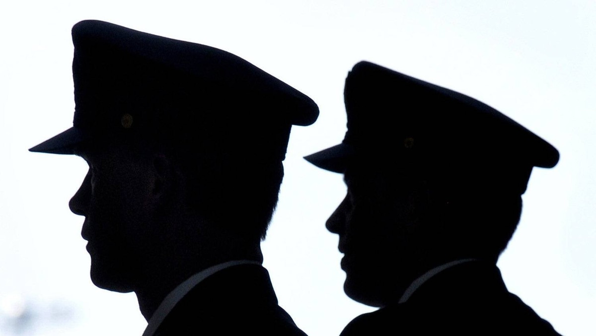 Air Canada pilots are silhouetted as they arrive at Toronto's Pearson airport, March 18, 2012.