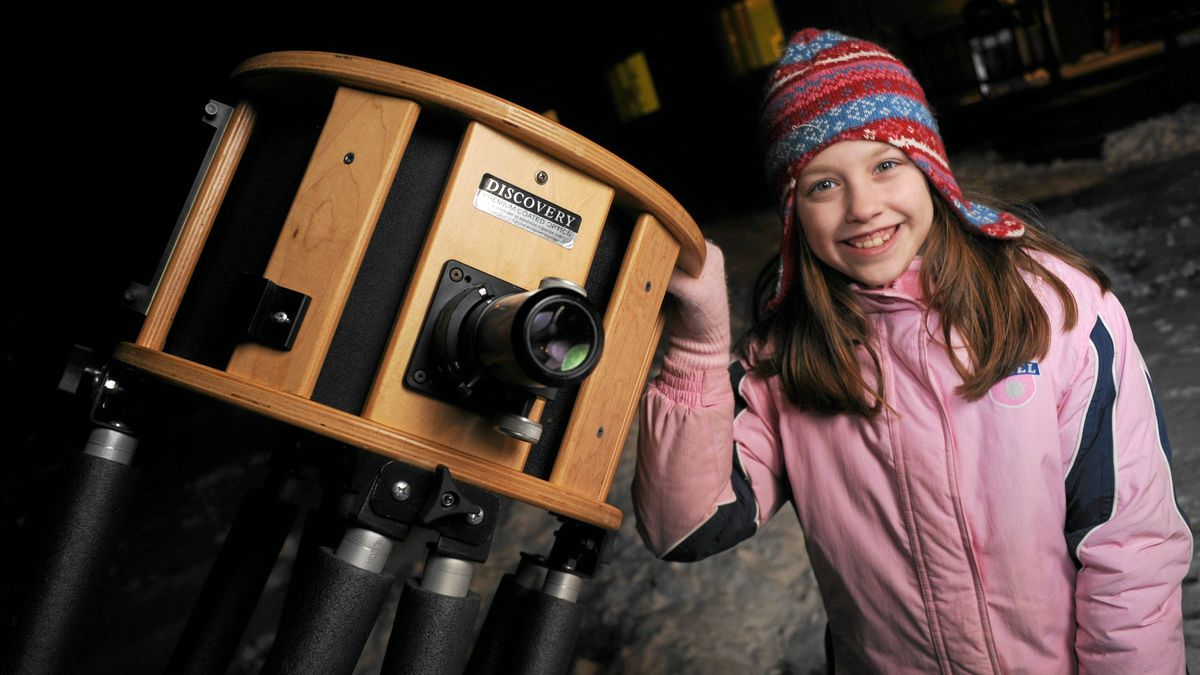 Kathryn Gray, 10, outside her home in Kingsley near Fredericton, New Brunswick, with her dad's reflectiong telescope.