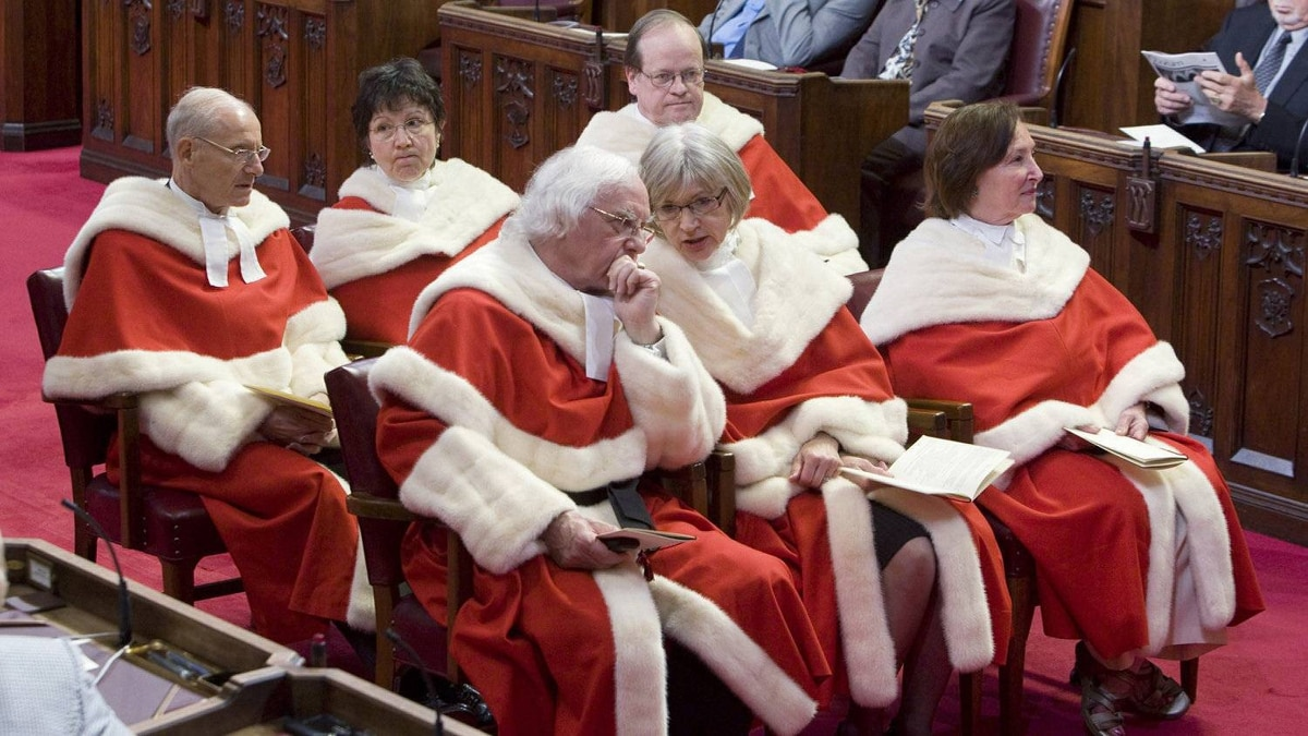 Justices of the Supreme Court wait for Governor General David Johnston to deliver the Speech from the Throne in the Senate Chamber on Parliament Hill in Ottawa, Friday June 3, 2011.