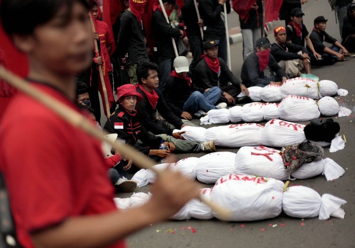 Indonesian workers display mock dead bodies representing the death of capitalism and imperialism during a rally to mark May Day in Jakarta, Indonesia. Thousands of Indonesian workers staged the rally demanding the government to raise minimum wage and reject outsourcing.