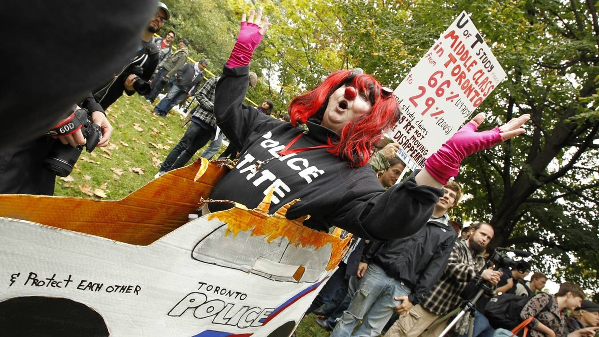 A protester at Occupy Toronto gets creative with her sign on October 15, 2011.