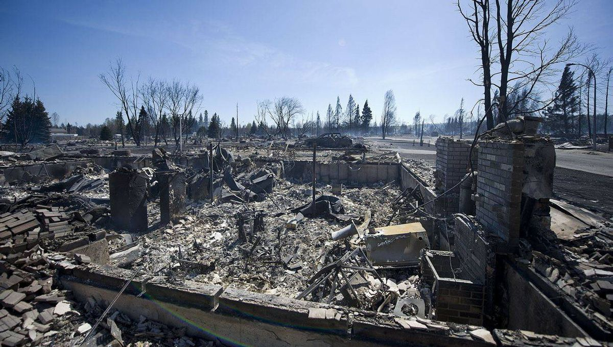 The burned out shell of homes are seen in Slave Lake Alberta after a forest fire ripped through the community.
