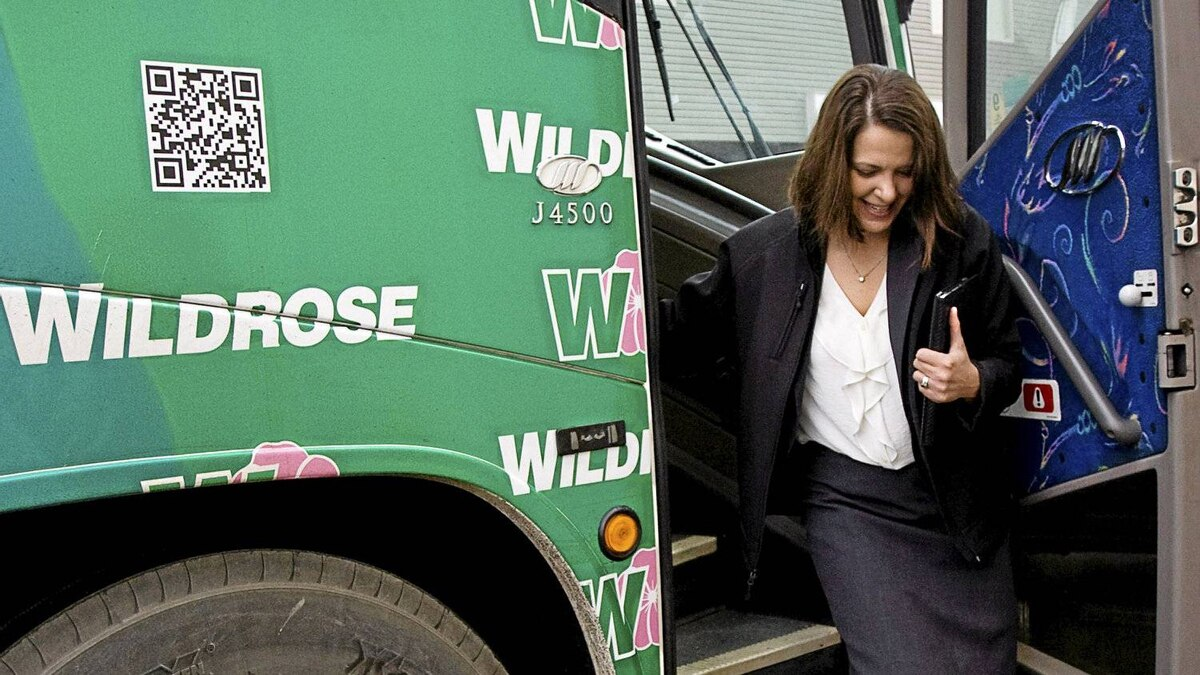 Wildrose party leader Danielle Smith exits her campaign bus to make a policy announcement in Okotoks, Alta., Tuesday, March 27, 2012. Albertans go to the polls on April 23.