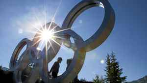 Tourists in Whistler, B.C. September 2, 2011 climb on the Olympic rings by Olympic Plaza which will be hosting the Whistler Jazz Festival this weekend.