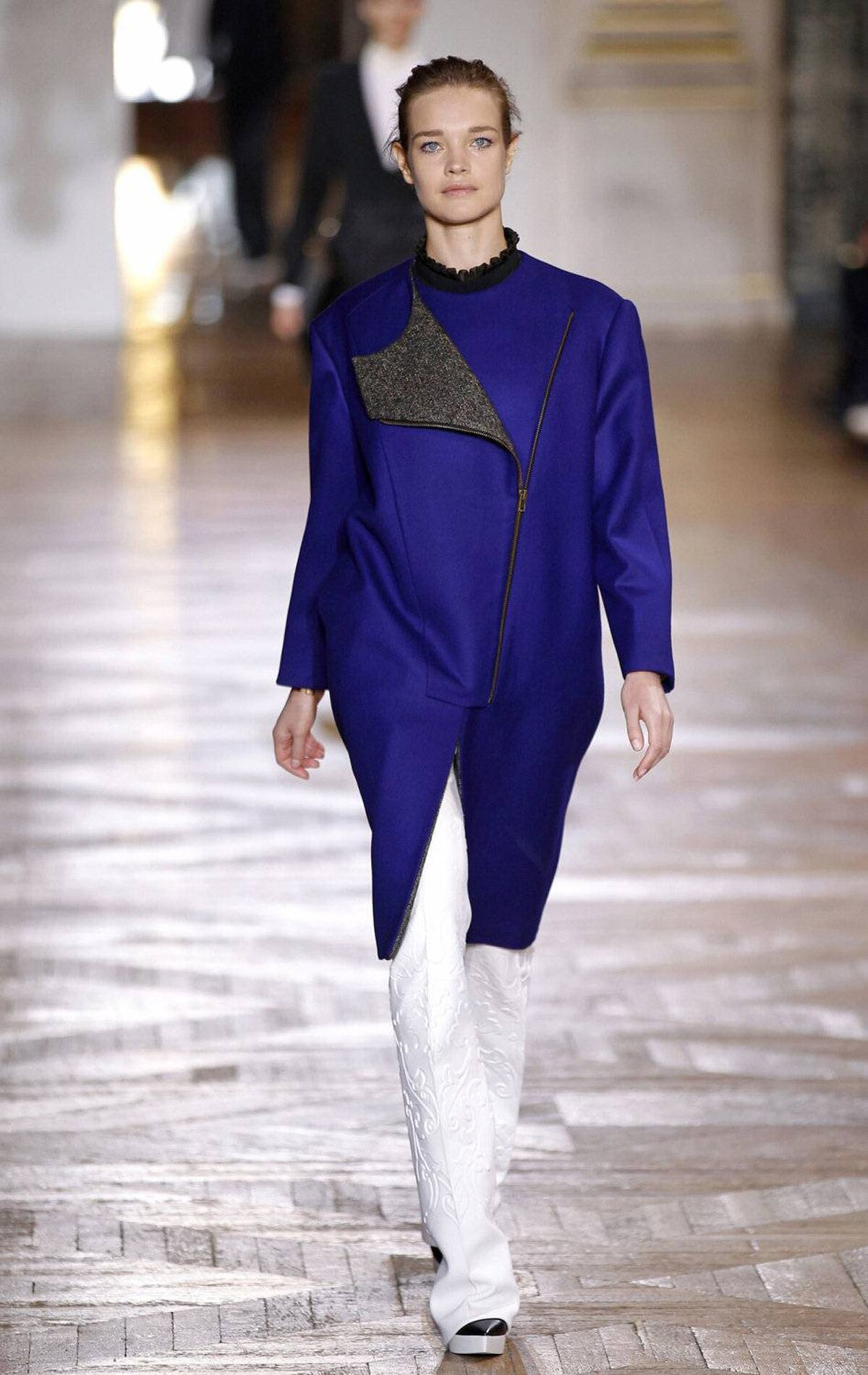 Meanwhile, McCartney sent out yet another strong collection, opening with an electric blue coat that that appears simple but is anything but. The tapered shape, diagonal zipper and trapezoidal lapel come together like a geometric equation.