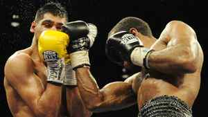 Amir Khan, left, of England, battles, Lamont Peterson, right, during a boxing match, Saturday, Dec. 10, 2011, in Washington. Khan was defeated in a split decision. (AP Photo/Nick Wass)