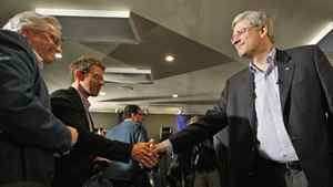 Conservative Leader Stephen Harper shakes hands with a supporter at a campaign rally in Beaupre, Que, on April 14, 2011.