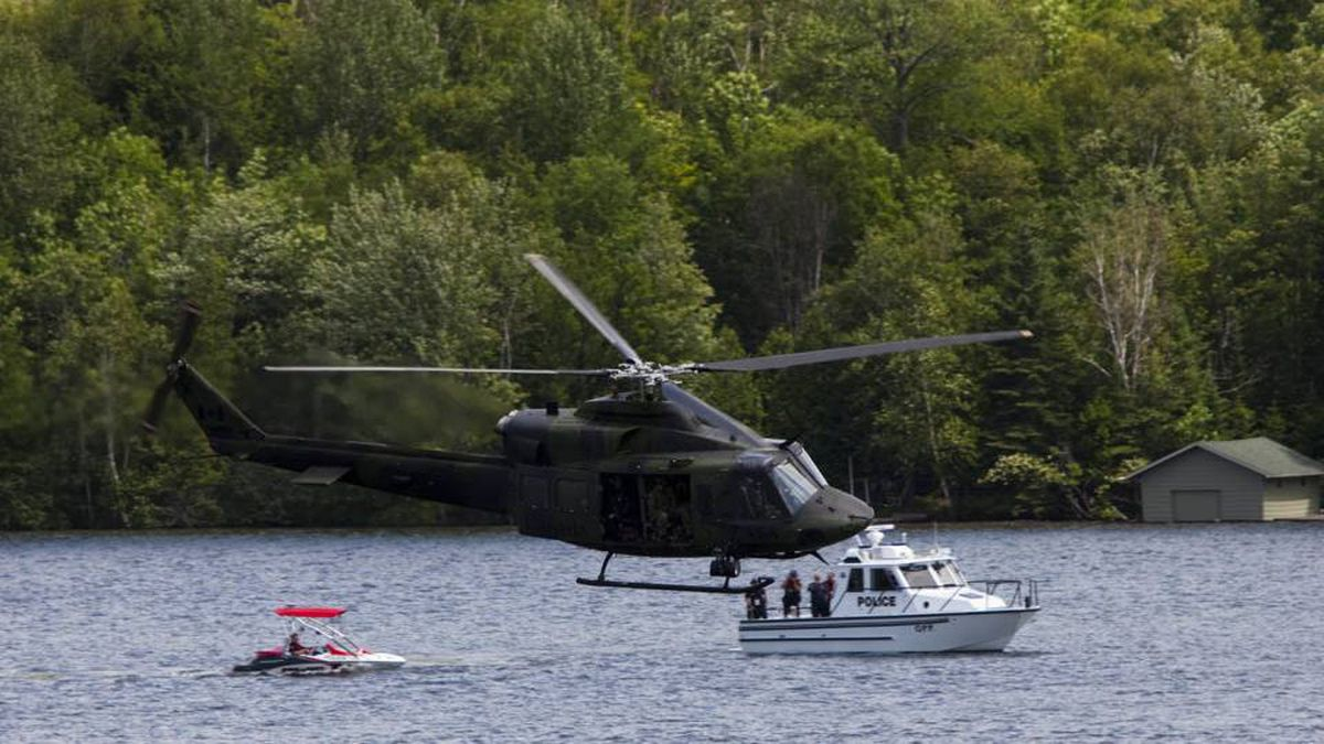 Canadian military helicopter and police boat patrol Peninsula Lake on the eve of leaders arriving at the Muskoka 2010 G8 summit at the Deerhurst Resort in Huntsville, Ont.