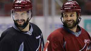 Phoenix Coyotes' Adrian Aucoin (L) and teammate Kyle Chipchura smile during their team practice in Glendale, Arizona May 14, 2012. The Coyotes are playing the Los Angeles Kings in Game 2 of the NHL Western Conference hockey finals on Tuesday. REUTERS/Todd Korol