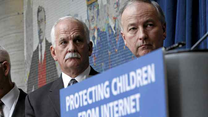 Public Safety Minister Vic Toews, left, and Justice Minister Rob Nicholson take part in a news conference to announce measures protecting children from internet predators, in Ottawa, on Feb. 14, 2012.