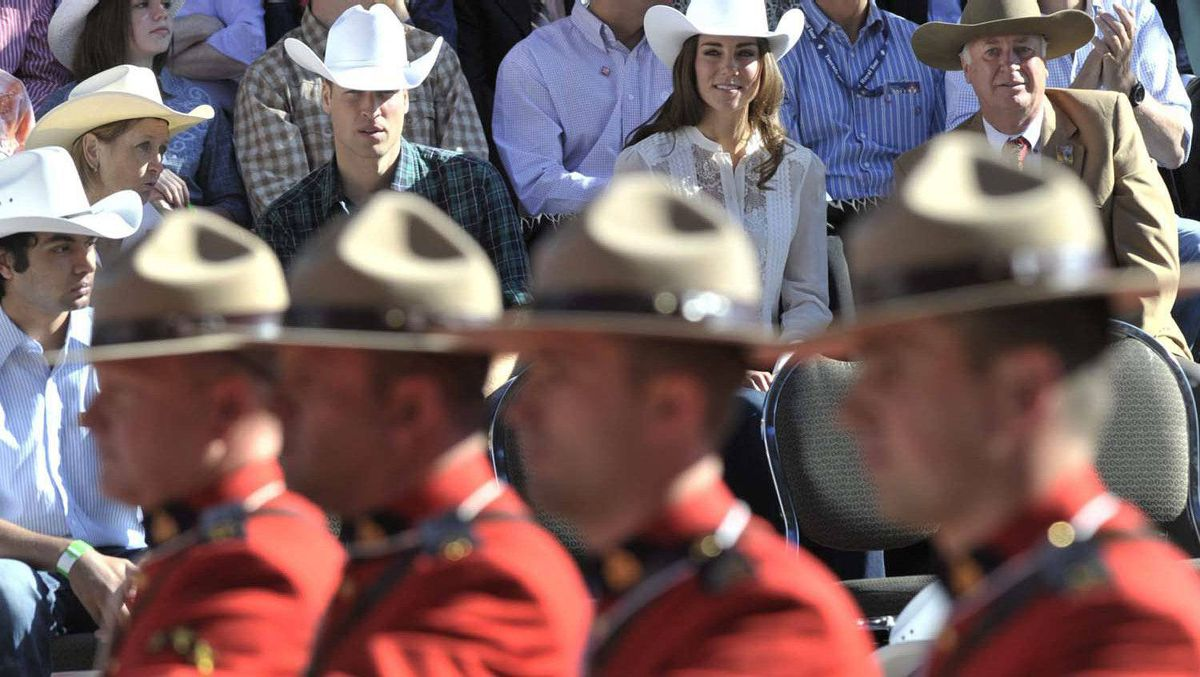 The Duke and Duchess of Cambridge watch the start of the Calgary Stampede parade in Calgary, Friday July 8, 2011.