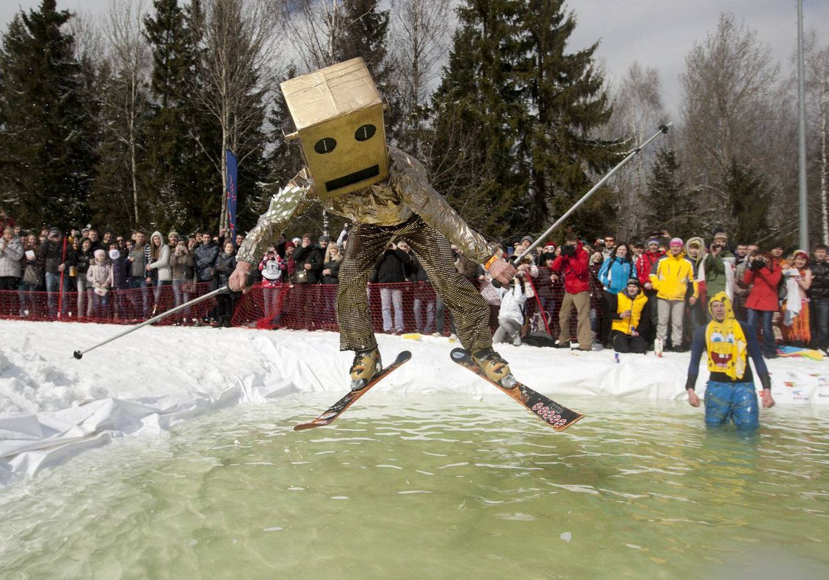 A skier jumps into a pool of water while taking part in an event to mark the closing of the ski season at Silichi ski resort, some 30 km (18 miles) outside the Belarussian capital Minsk, April 1, 2012.