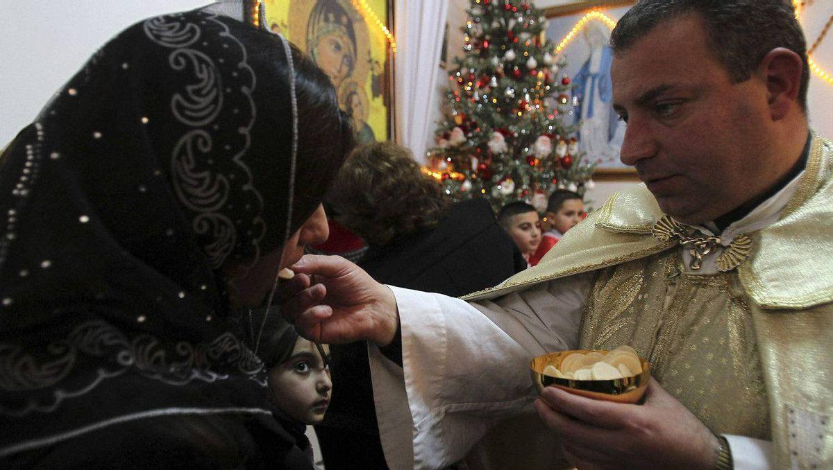 Iraqi Christians attend mass on Christmas eve at Chaldean Catholic church in Amman December 24, 2011.