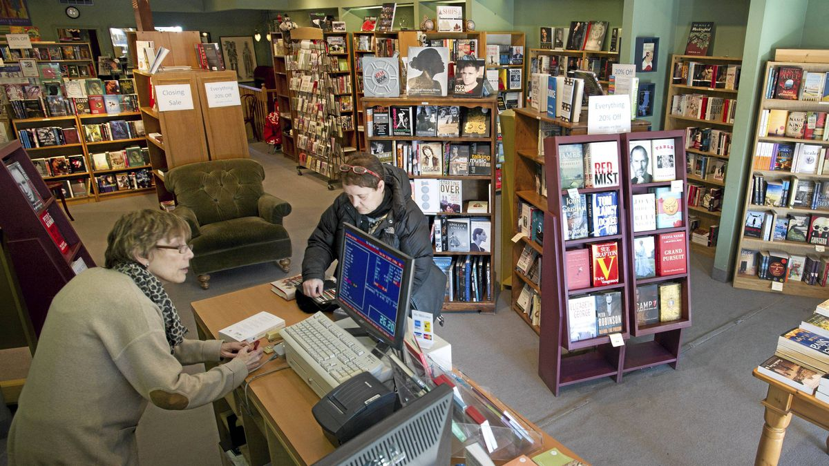 A staff member helps a customer at The Book Mark located on Bloor Steet in Etobicoke, Ont. on Jan. 3, 2012. After 46 years of doing business in The Kingsway, the neighbourhood bookstore is closing.