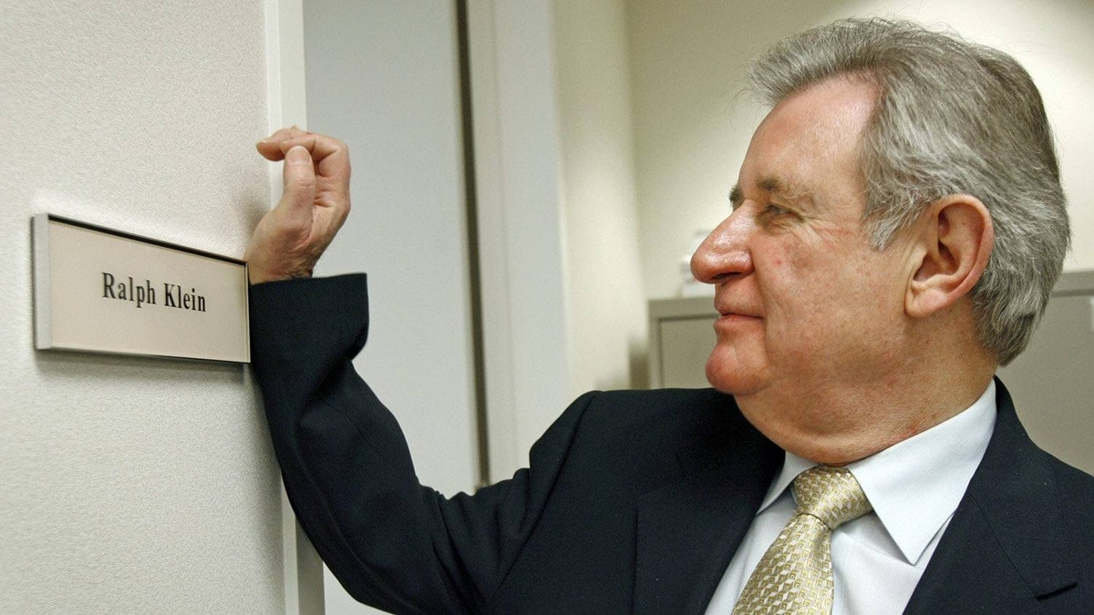 Mr. Klein polishes his name plate outside his new office at a Calgary law firm on Jan. 19, 2007 after being hired as the firm's senior business advisor.