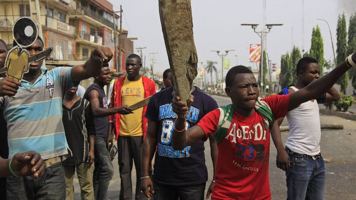 People protest following the removal of a fuel subsidy by the government in Lagos, Nigeria, Monday, Jan. 9, 2012. A national strike paralyzed much of Nigeria on Monday, with more than 10,000 demonstrators swarming its commercial capital to protest soaring fuel prices and decades of government corruption in the oil-rich country.