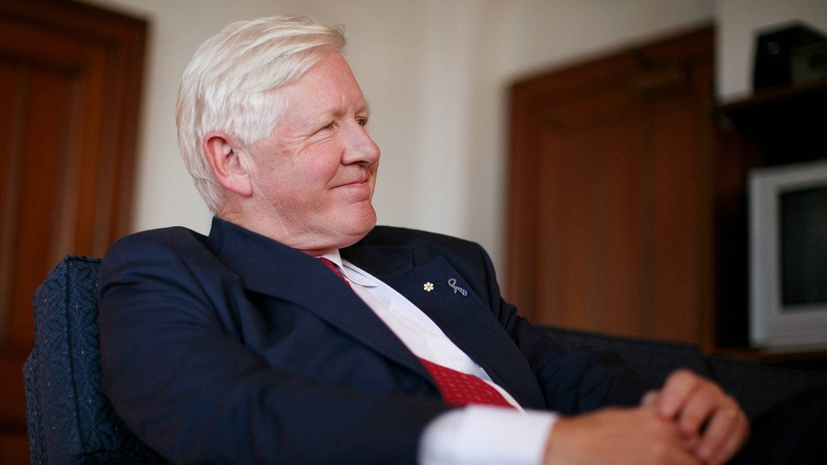 Interim Liberal leader Bob Rae smiles during an interview at his office on Parliament Hill in Ottawa.
