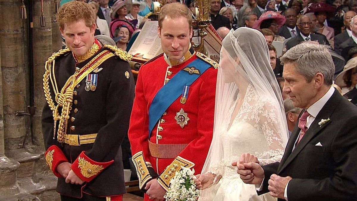 In this image taken from video, from right ,father of the bride, Michael Middleton, Kate Middleton, Britain's Prince William and Britain's Prince Harry stand at the alter at Westminster Abbey for the Royal Wedding in London on Friday, April, 29, 2011.