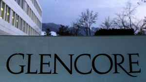 Swiss commodities trader Glencore's logo is seen in front of its headquarters in Baar, near Zurich, February 6, 2012.