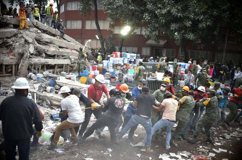 Rescuers struggle to save trapped girl as Mexico hunts for earthquake survivors