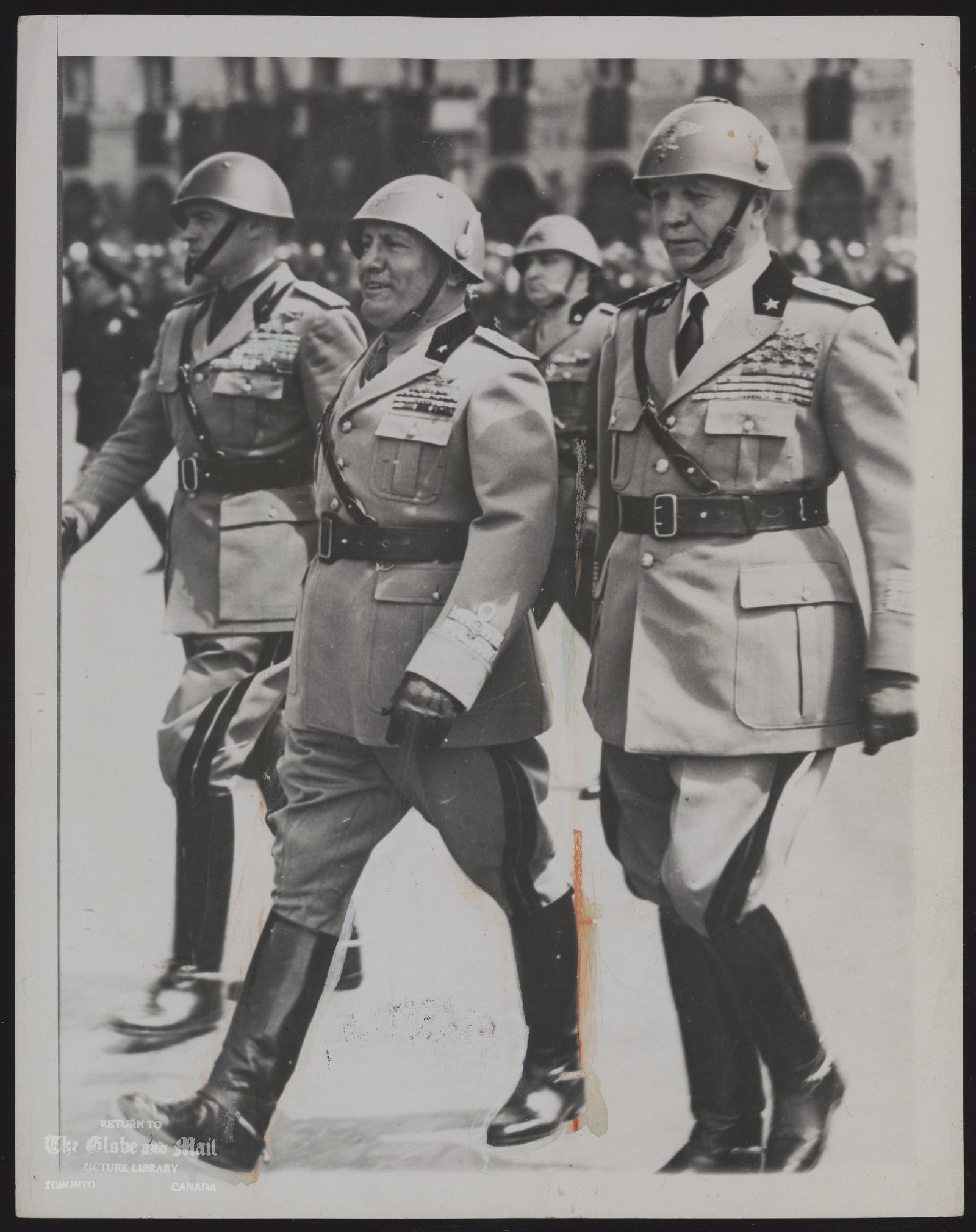 Benito MUSSOLINI, ITALY Associated Press Photo From New York Caution: Use Credit MUSSOLINI OUT, BADOGLIO IN BENITO MUSSOLINI (CENTER) WALKED WITH MARSHAL PIETRO BADOGLIO (RIGHT) AND FASCIST SECRETARY ETTOR MUTI (LEFT) AFTER AN ARMY REVIEW IN 1940. THE ROME RADIO ANNOUNCED JULY 25 THAT BADOGLIO HAD SUCCEEDED MUSSOLINI AS PRIME MINISTER OF ITALY. Associated Press Photo 7/25/43 RJB 605p FLS ABC NYC NRSL NICK GD SU MON TorG&M NYT TMO LON MEX BAIRES SABC 71