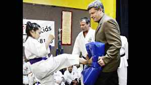 Stephen Harper (right) takes part in a karate demonstration as chief instructor Tom Burtnik (centre) looks on in St. Catharines, Ont., Saturday, Dec. 10, 2005.