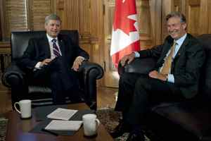 Prime Minister Stephen Harper meets with the new ambassador-designate to the United States Gary Doer in his Parliament Hil office on Aug. 28, 2009.