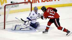 Ottawa Senators' Zach Smith scores on Tampa Bay Lightning goalie Dwayne Roloson during the third period in Ottawa Dec. 5, 2011.