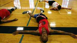 Prospects strech during a training camp at Humber College Lakeshore Campus in preparation for the National Basketball League of Canada's draft this weekend in Toronto, Ont., on August 16, 2011. (Michelle Siu / The Globe and Mail)