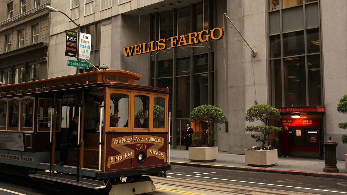A cable car passes the Wells Fargo Bank headquarters in the Financial District in San Francisco, California March 28, 2012.