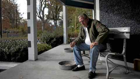 Russell Varner, 56, sits on the porch at a privately owned home for veterans on Park Avenue on Mon., Oct. 31, 2011, in Salisbury, N.C.