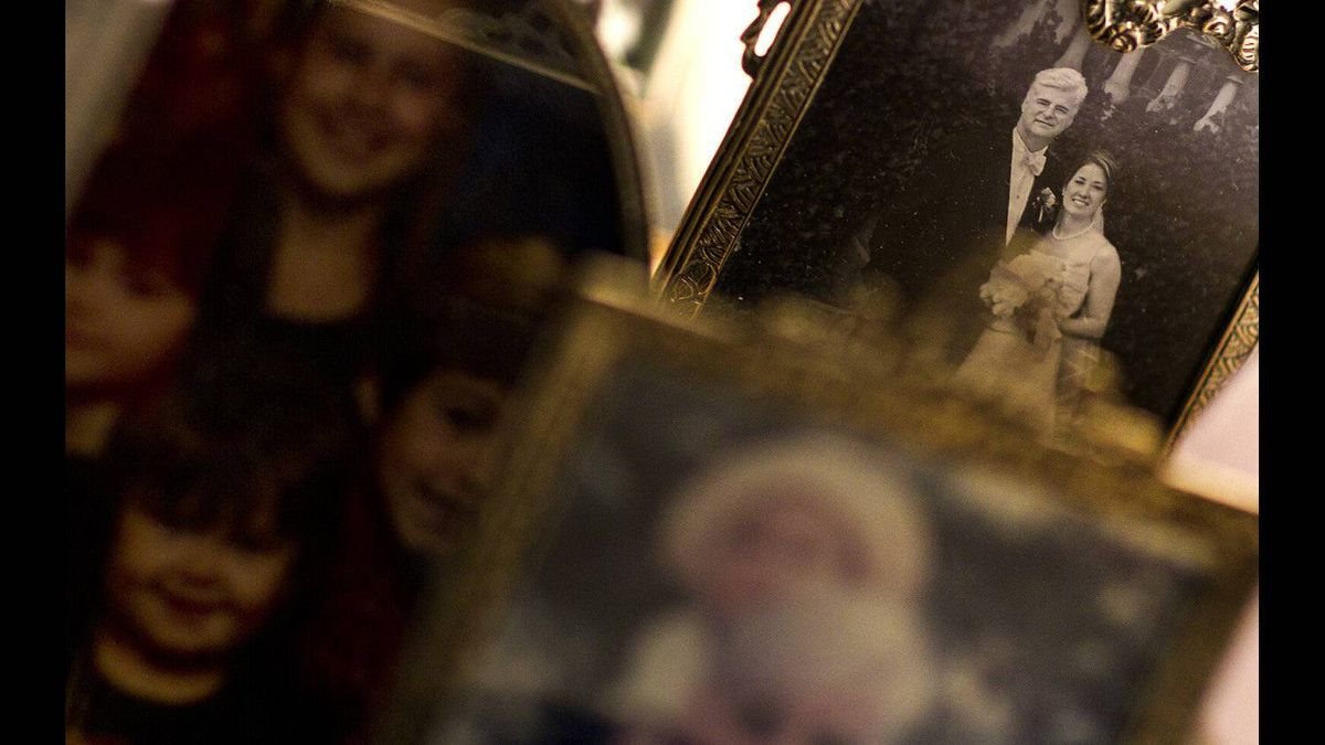 A wedding portrait of Andrew McCarthy and his wife, Marianne Kupina, sits among other family photos on his bedside at Kensington Hospice in Toronto on Feb. 12, 2012 where Mr. McCarthy was resident.
