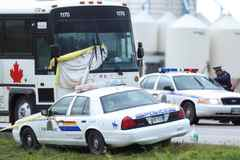 The RCMP investigate the scene of Tim McLean's murder on a Greyhound bus July 31, 2008 near Portage La Prairie, Man.