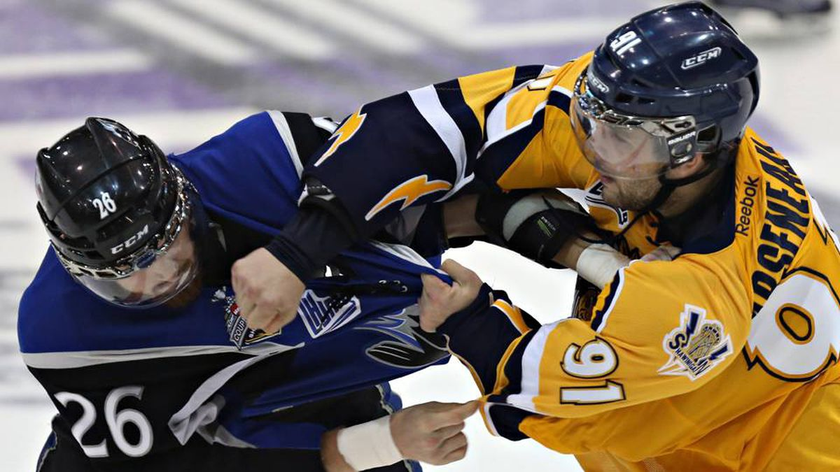 Saint John Sea Dogs Grant West, left, and Shawinigan Cataractes Vincent Arseneau fight during third period Memorial Cup action in Shawinigan Que., on Wednesday, May 23, 2012.