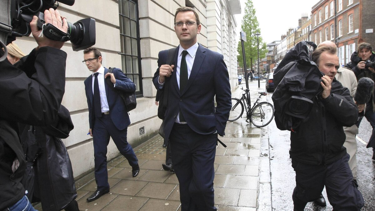 Andy Coulson, middle, former editor of the News of the World and former spokesman for Britian's Prime Minister David Cameron, leaves after giving evidence before the Leveson Inquiry into the ethics and practices of the media at the High Court in central London on Thursday.