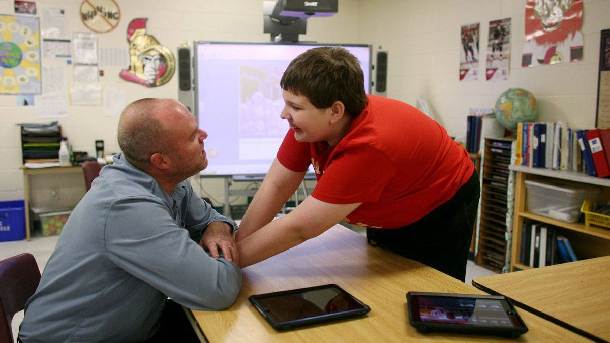 Braeden Barr speaks with his teacher Dave Balfour at Chimo Public School in Smith Falls, Ontario on Jan. 18, 2012.