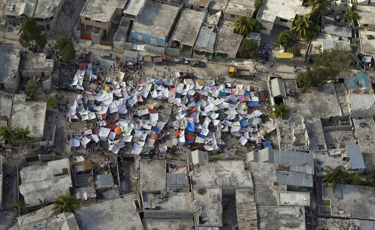 "A photo released on January 14, 2010 from the UN Minustah mission showing an impromptu tent city set up in Port-au-Prince following a devastating earthquake on January 12, 2010. UN and aid agencies warned on January 14, 2010 that they faced a ""major logistic challenge"" in getting essential relief to survivors of Haiti's deadly earthquake."