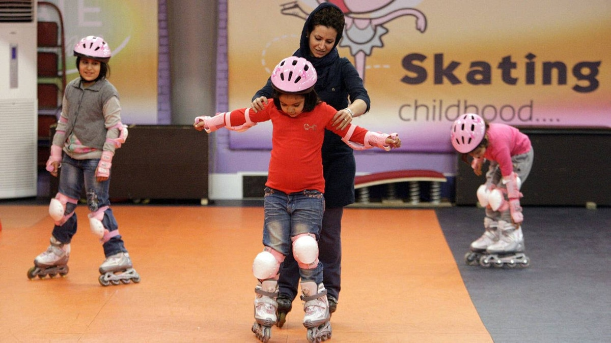 Iranian woman Mahnaz Mollaei, center background, teaches rollerblading to a girl at the Pardis club, in the central city of Isfahan, 390 km south of the capital Tehran, Iran, Sunday, Jan. 1, 2012.