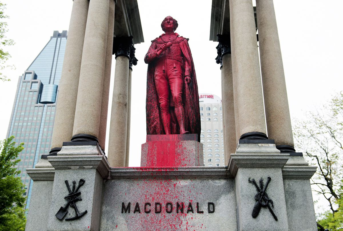 Montreal statue of Sir John A. Macdonald spray-painted red by activists