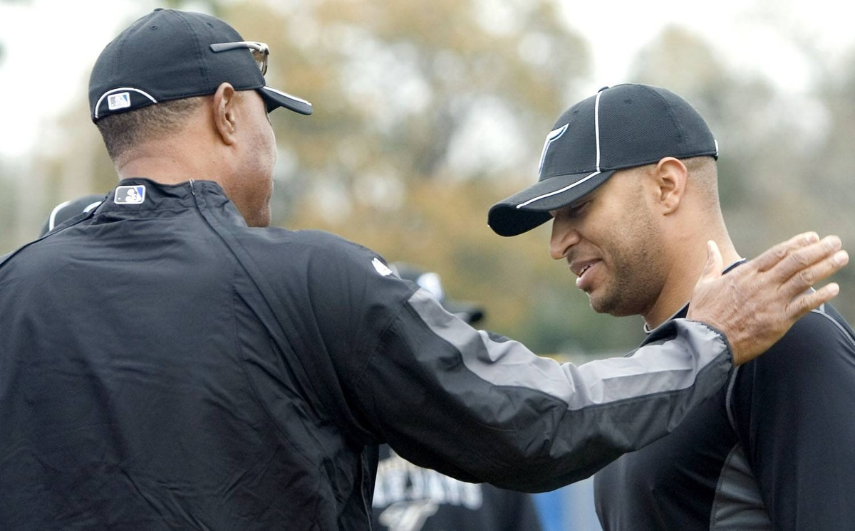 Toronto Blue Jays Vernon Wells (R) talks to team manager Cito Gaston around the batting cage at the team's MLB baseball spring training facility in Dunedin, Florida February 24, 2010. It was veteran Wells' first day at training camp. REUTERS/Fred Thornhill