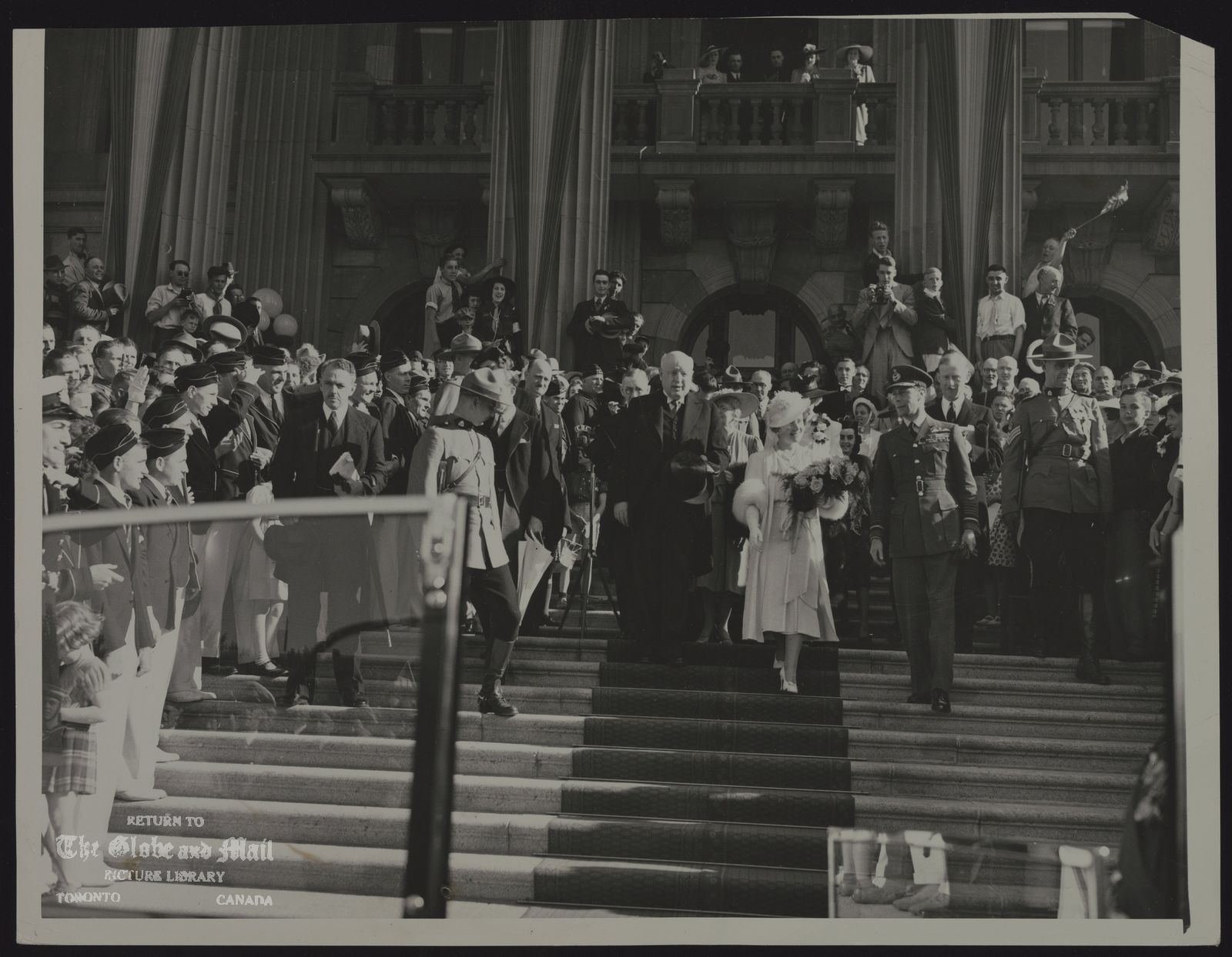ROYAL FAMILY GREAT BRITAIN KING GEORGE VI QUEEN ELIZABETH VISIT TO CANADA, 1939. KING AND QUEEN LEAVE HOUSE OF PARLIAMENT. EDMONTON, ALTA. CANADA -- PREMIER WILLIAM ABERHART OF EDMONTON (LEFT) IS SHOWN WITH KING GEORGE VI AND QUEEN ELEZABETH OF ENGLAND AS THEY LEFT THE PARLIAMENT BUILDING DURING THE VISIT OF THE ENGLISH RULERS HERE JUNE 2ND, [1939]. THEIR MAJESTIES WERE WELCOMED HERE BY A CROWD OF 90,000 PERSONS WHO TURNED OUT TO SHOW THEIR FEALTY TO THE KING AND QUEEN.