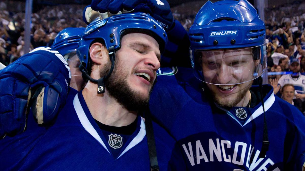 Vancouver Canucks' Kevin Bieksa, left, who scored the game-winning goal, and Alexander Edler, of Sweden, celebrate after defeating the San Jose Sharks in the second overtime period of game 5 of the NHL Western Conference Final Stanley Cup playoff hockey series in Vancouver, B.C., on Tuesday May 24, 2011.