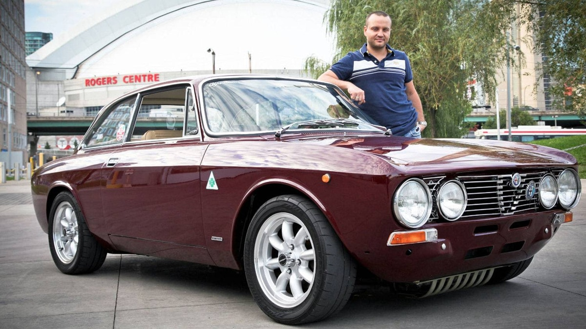 David Minicucci leans on his dream car: a 1973 Alfa Romeo 2000 GTV. The Toronto restaurateur's love affair with the vehicle began when he was five.