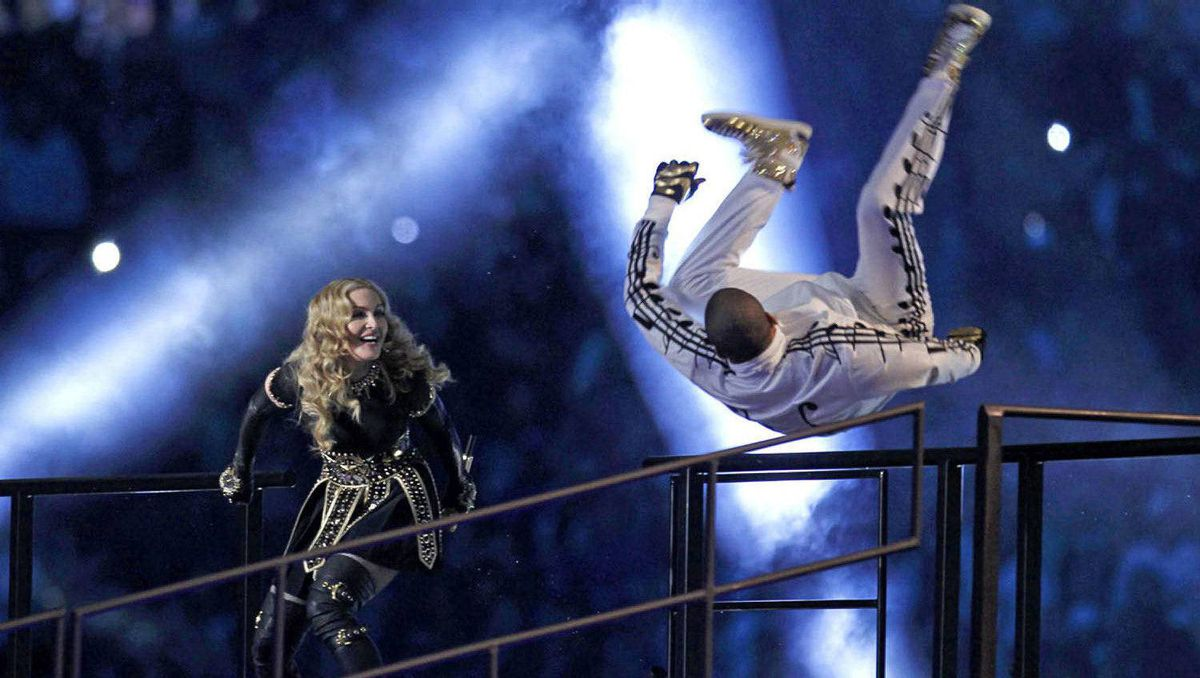 Singer Madonna and a dancer perform during the halftime show.
